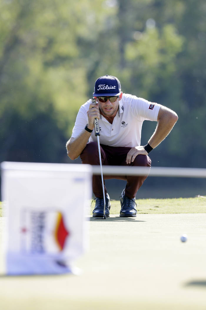 Lanto Griffin lines up his putt on the eighth green during the fourth round of the Houston Open ...