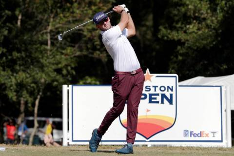 Lanto Griffin tees off on the second hole during the fourth round of the Houston Open golf tour ...