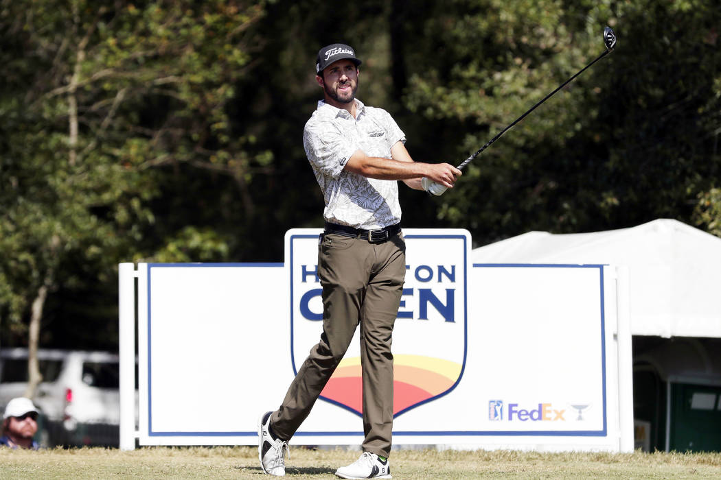 Mark Hubbard watches his tee shot on the second hold during the fourth round of the Houston Ope ...