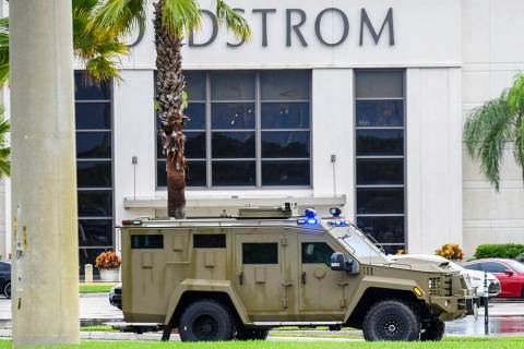 An armored police vehicle enters the Town Center at Boca Raton parking lot in front of Nordstro ...