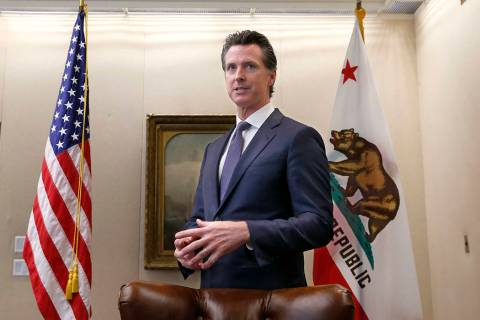 FILE - In this July 12, 2019, file photo, Gov. Gavin Newsom talks with reporters at his office ...