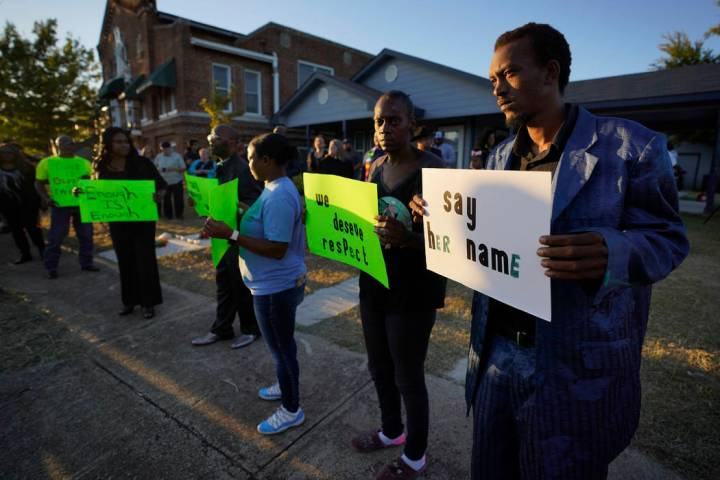 Protesters gather outside the house, right, where Atatiana Jefferson was shot Saturday and kill ...