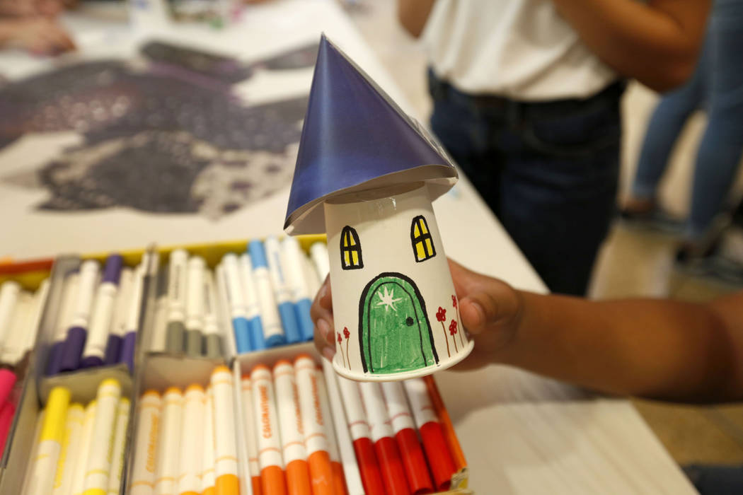 Instructor Hayden Gabriel of Las Vegas shows a fairly house during Mystic Fair at Windmill Libr ...