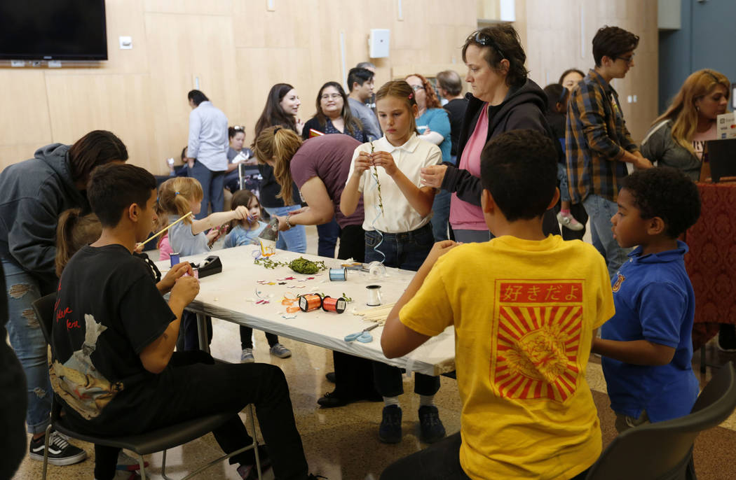 Children make wands during Mystic Fair at Windmill Library in Las Vegas, Friday, Oct.11, 2019. ...