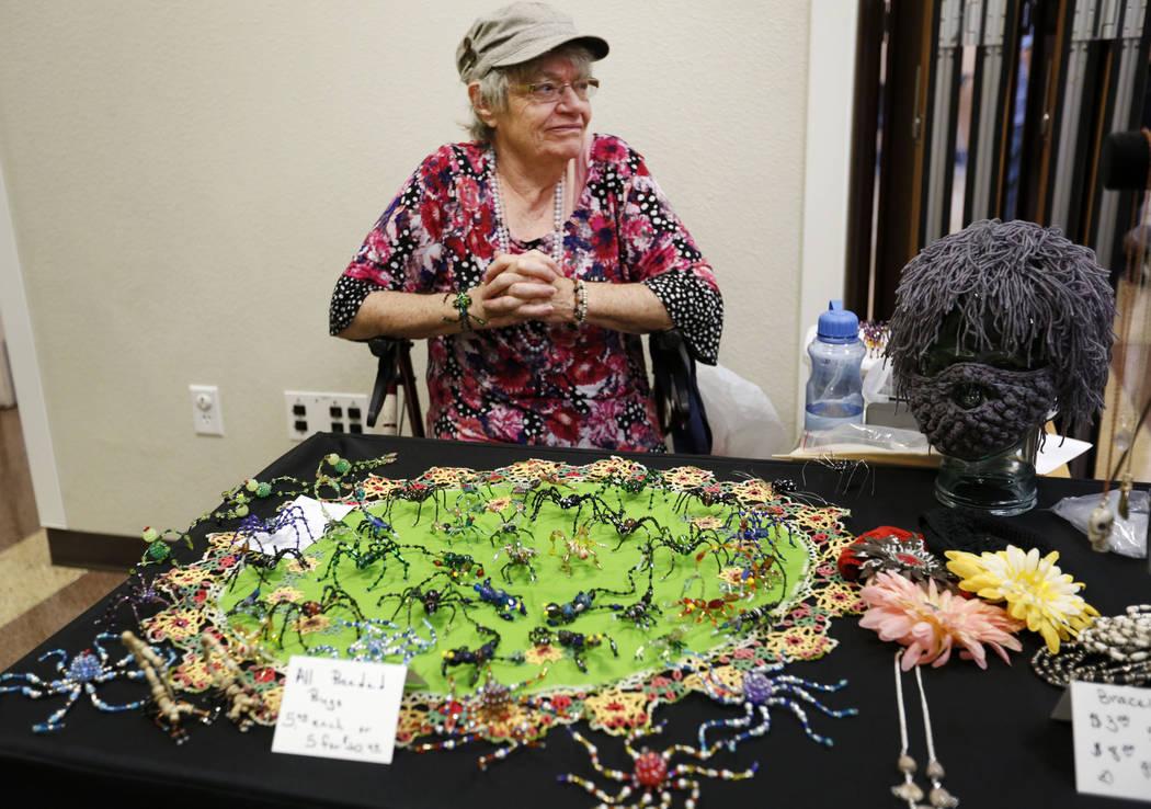 Karen Byrne, 74, of Third Eye Gifts in Las Vegas sells her beaded artworks during Mystic Fair a ...
