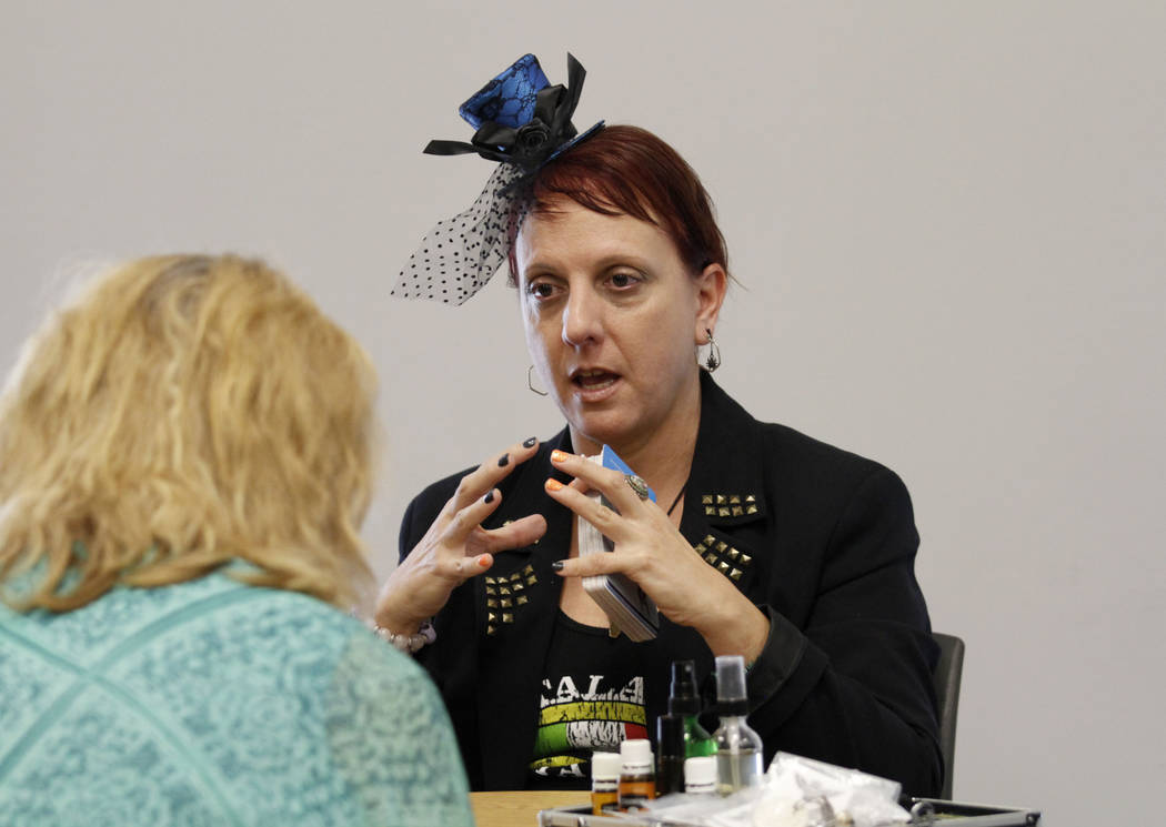Local psychic Nicole Borghi talks with her client during Mystic Fair at Windmill Library in Las ...