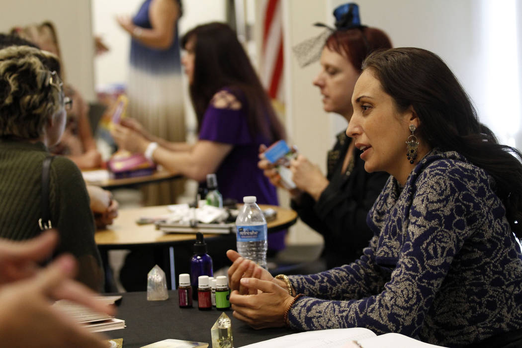 Local psychic Jennifer Pulcini talks with her client during Mystic Fair at Windmill Library in ...
