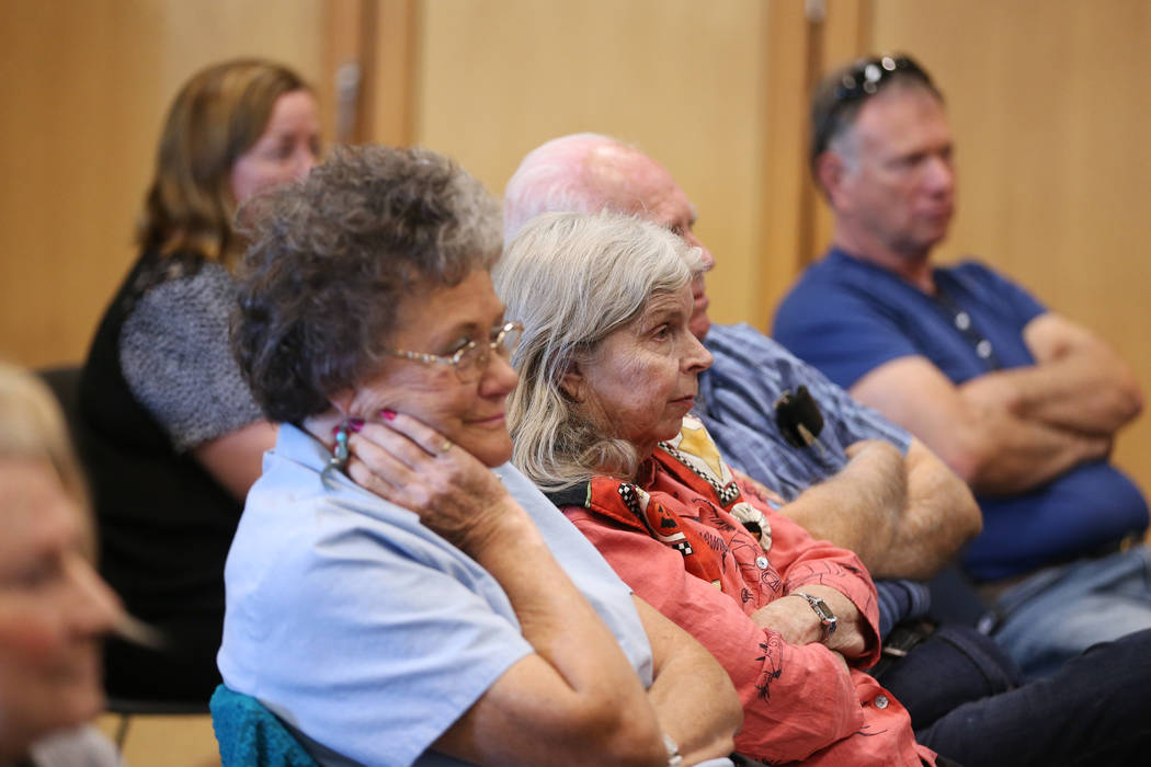People listen to Stuart Holbrook, president of Theriault's, speak during the Thirty Years a Dol ...