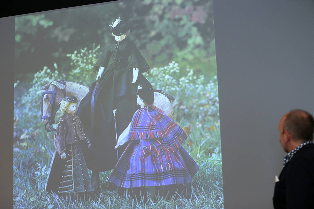 Stuart Holbrook, president of Theriault's, gives a presentation on dolls during the Thirty Year ...