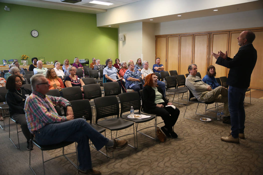 Stuart Holbrook, president of Theriault's, speaks during the Thirty Years a Doll Man event at t ...