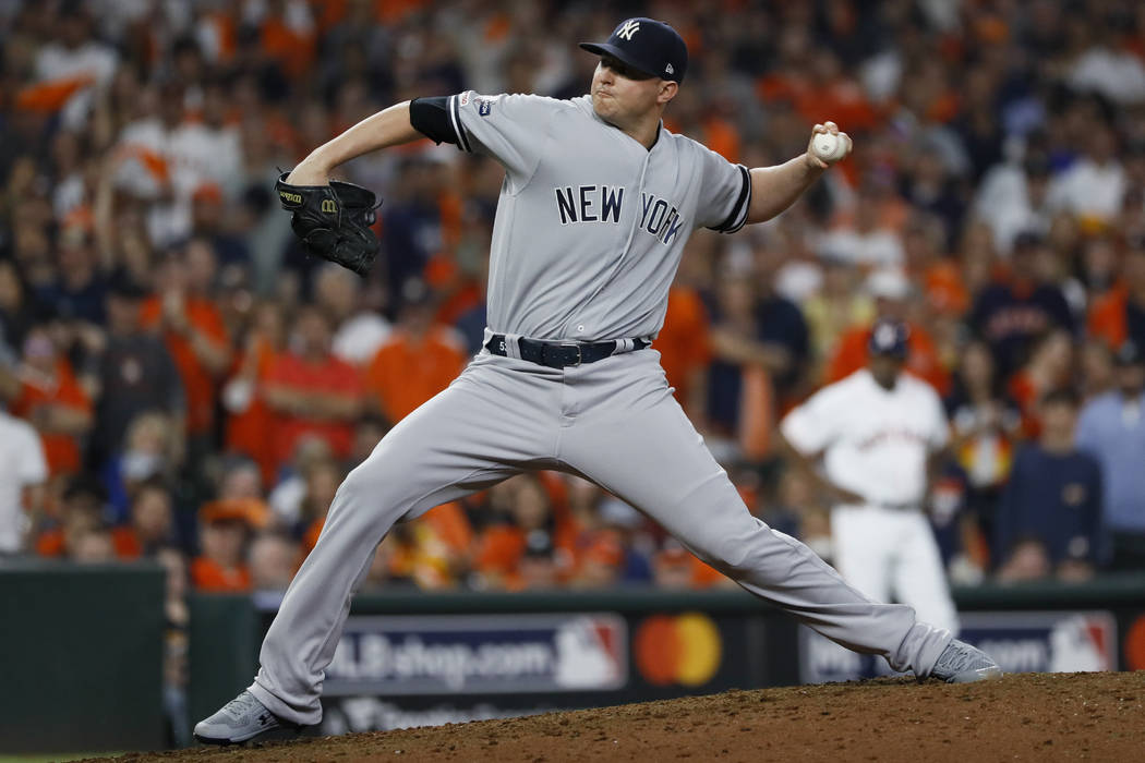 New York Yankees relief pitcher Zack Britton throws against the Houston Astros during the eight ...