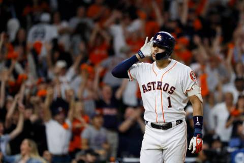 Houston Astros shortstop Carlos Correa celebrates after his walk-off home run against the New Y ...
