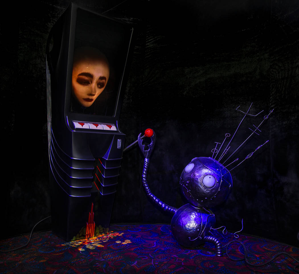 "Art piece ""Robot Boy and Slot Machine"" by Tim Burton in his Lost Vegas art exhibition ..."