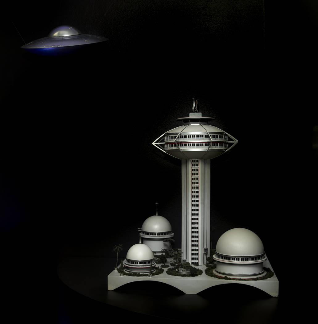"Art pieces ""Space Saucer With Dents"" at left and ""Model for the LandMark Hotel a ..."