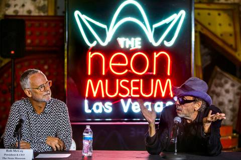 Director and artist Tim Burton, right, speaks to Neon Museum President & CEO Rob McCoy abou ...