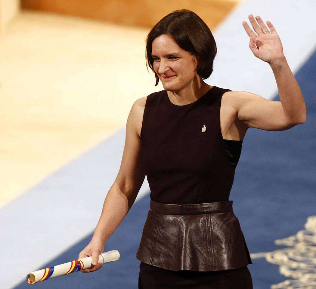 In a Friday Oct. 23, 2015, file photo, Esther Duflo of France waves after receiving the Princes ...