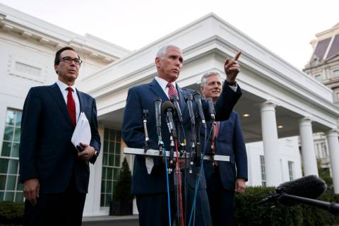 Vice President Mike Pence, with Treasury Secretary Steven Mnuchin, left, and national security ...