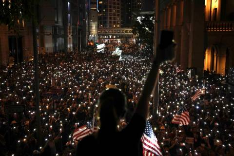 Protestors light their torches during a peaceful rally in central Hong Kong's business district ...