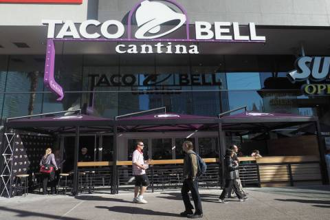 Pedestrians walk by the new Taco Bell Cantina in the Harmon Center in Las Vegas, Monday, Nov. 1 ...