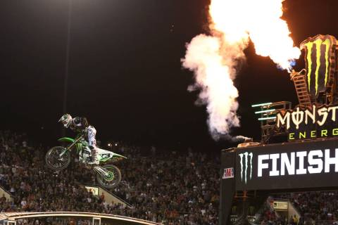 Eli Tomac makes his final jump to win the 2018 Monster Energy Cup Race at Sam Boyd Stadium on S ...