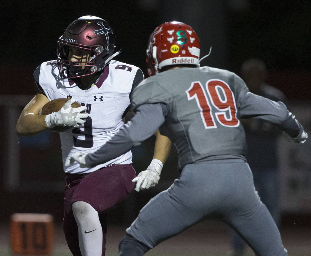 Faith Lutheran junior running back Marcos Canales (9) cuts up field past Arbor View senior defe ...