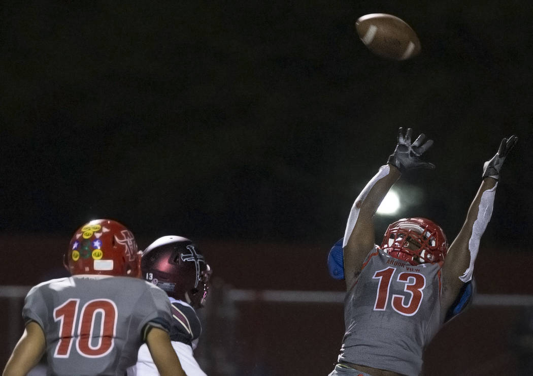 Arbor View sophomore defensive back D'Andre Washington (13) leaps to try and make an intercepti ...