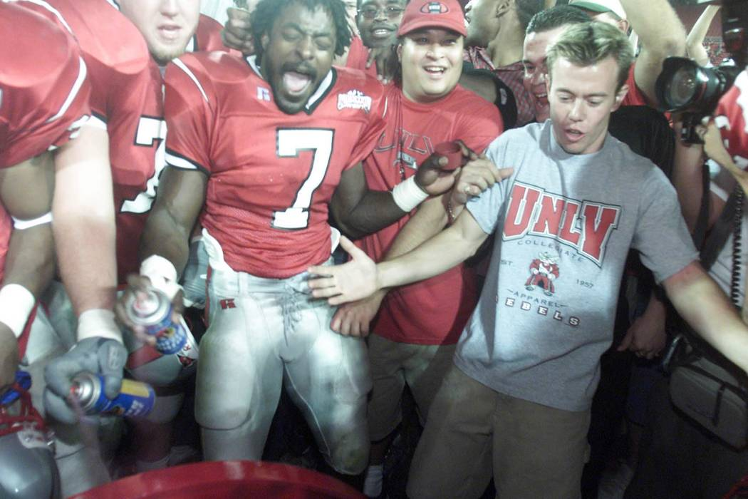 Sports; 10-07-00, UNLV#7 Jeremi Rudolph spray paints the Fremont Cannon after the Rebels victo ...