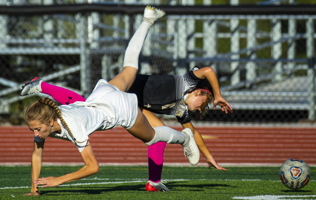 Arbor View's Abby Cassano (6, left) and Faith Lutheran's Camille Longabardi (6) collide over th ...