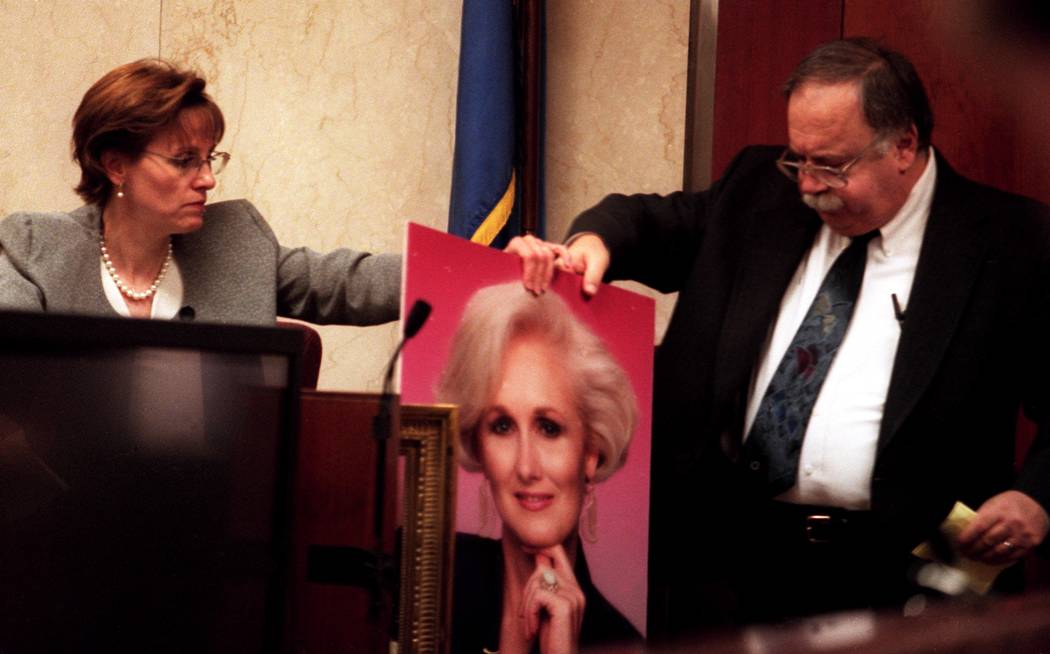Linda Erechetta and attorney Tom Pitaro discuss blood marks while holding a portrait of Margare ...