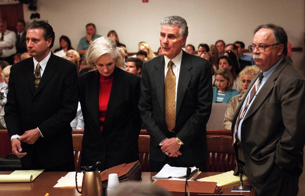 Margaret Rudin drops her head while her attorneys Michael Amador, left to right, John Momot and ...