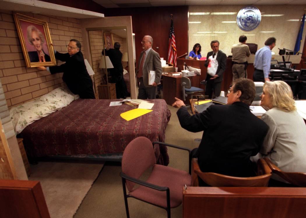 Defense attorney Tom Pitaro places a portrait of Margaret Rudin while defense investigator Mike ...