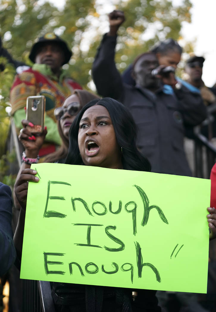 Carol Harrison-Lafayette protests the police shooting of Atatiana Jefferson during a community ...