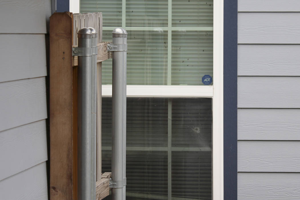 A bullet hole could be seen in the back window outside the Fort Worth home Monday, Oct. 14, 201 ...
