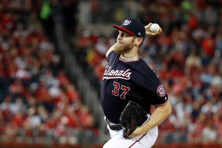 Washington Nationals starting pitcher Stephen Strasburg throws during the first inning of Game ...