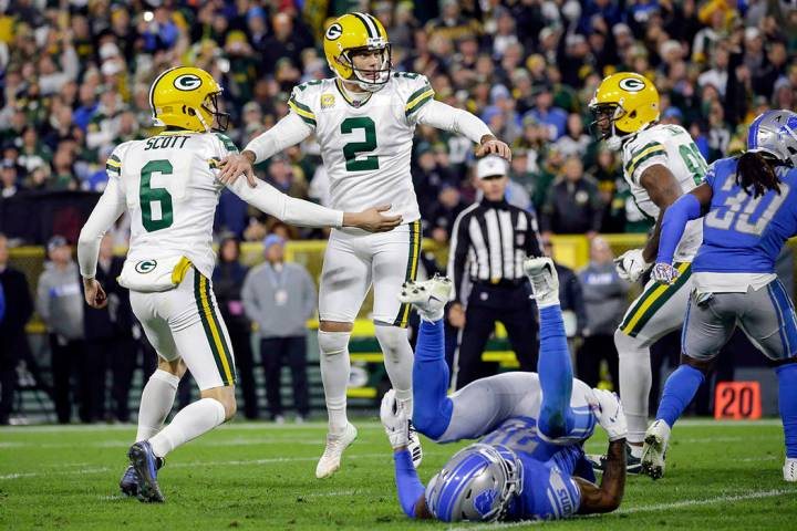 Green Bay Packers kicker Mason Crosby (2) celebrates scoring the winning field goal with punter ...