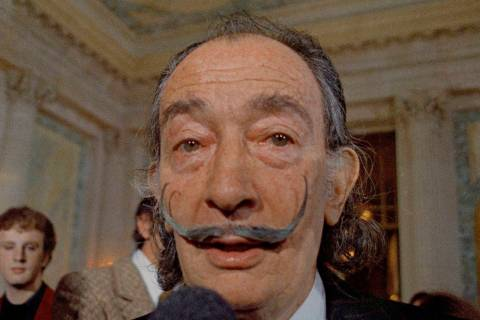FILE - In this May 21, 1973 file photo, Spanish surrealist painter Salvador Dali, presents his ...