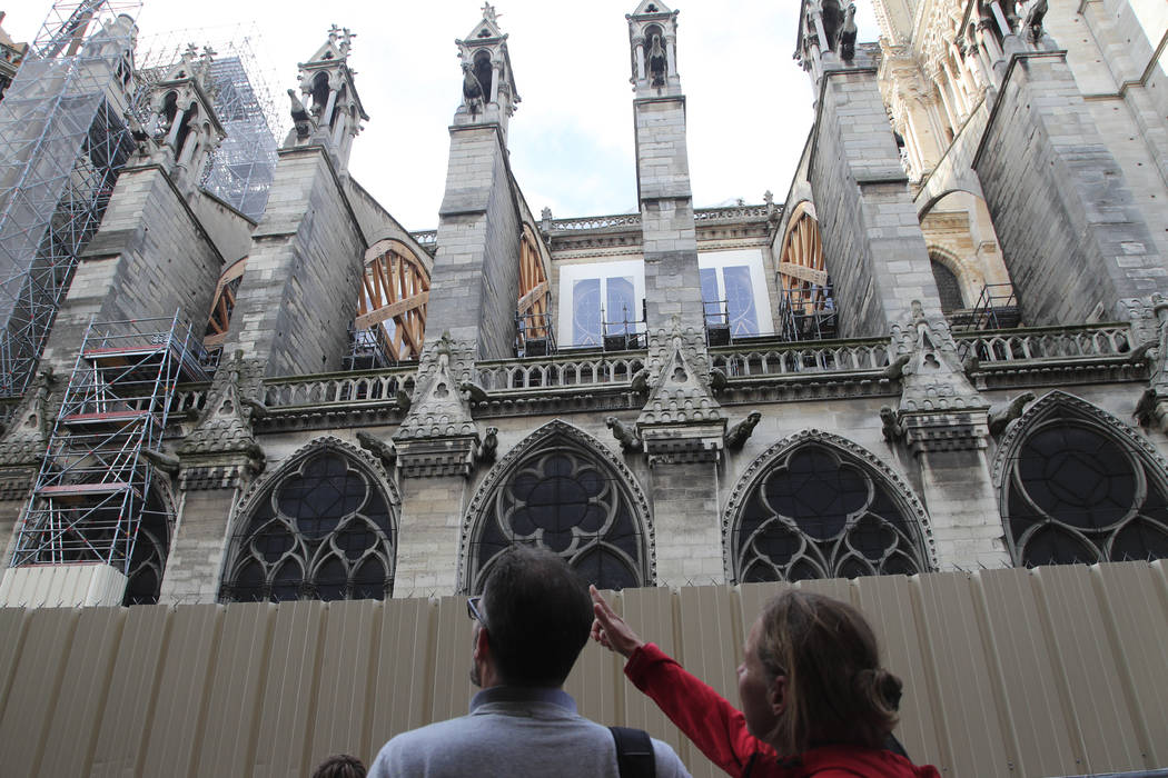 People walk by Notre Dame cathedral Tuesday, Oct. 15, 2019 in Paris. French Culture Minister Fr ...