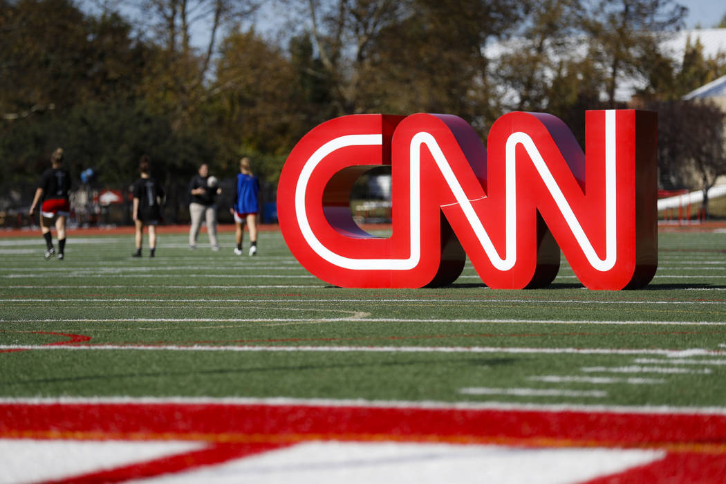 A CNN sign rests on an athletic field outside the Clements Recreation Center where the CNN/New ...