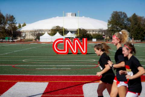 Student athletes pass a CNN sign on an athletic field outside the Clements Recreation Center on ...