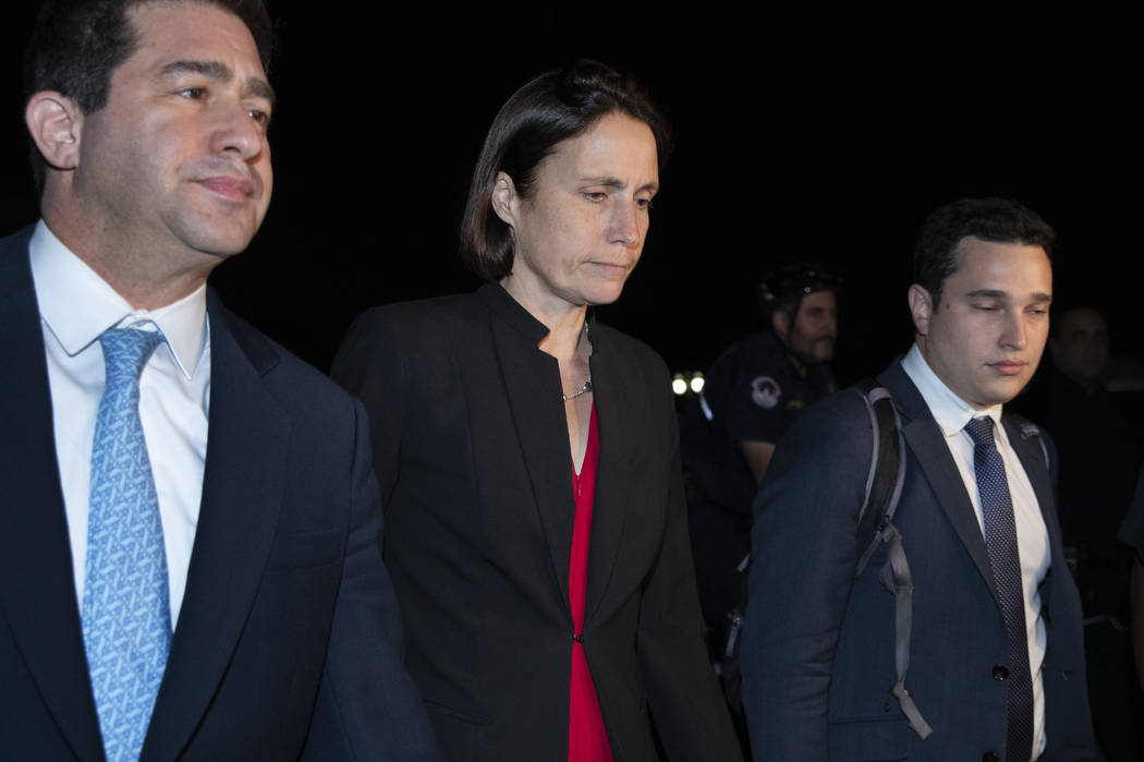 Former White House advisor on Russia, Fiona Hill, center, leaves Capitol Hill in Washington, Mo ...