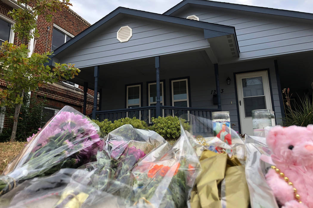 Bouquets of flowers and stuffed animals are piling up outside the Fort Worth home Monday, Oct. ...