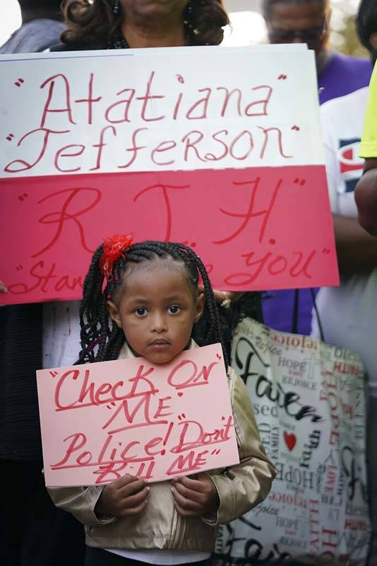 Trinity Ford, 4, joins the crowd gathered during a community vigil for Atatiana Jefferson on Su ...