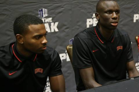 UNLV players from left, Amauri Hardy, Cheikh Mbacke Diong, and head coach T. J. Otzelberger, pa ...