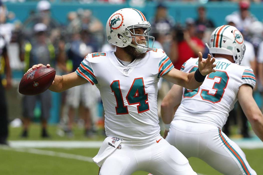 In this Sept. 15, 2019, file photo, Miami Dolphins quarterback Ryan Fitzpatrick (14) looks to p ...