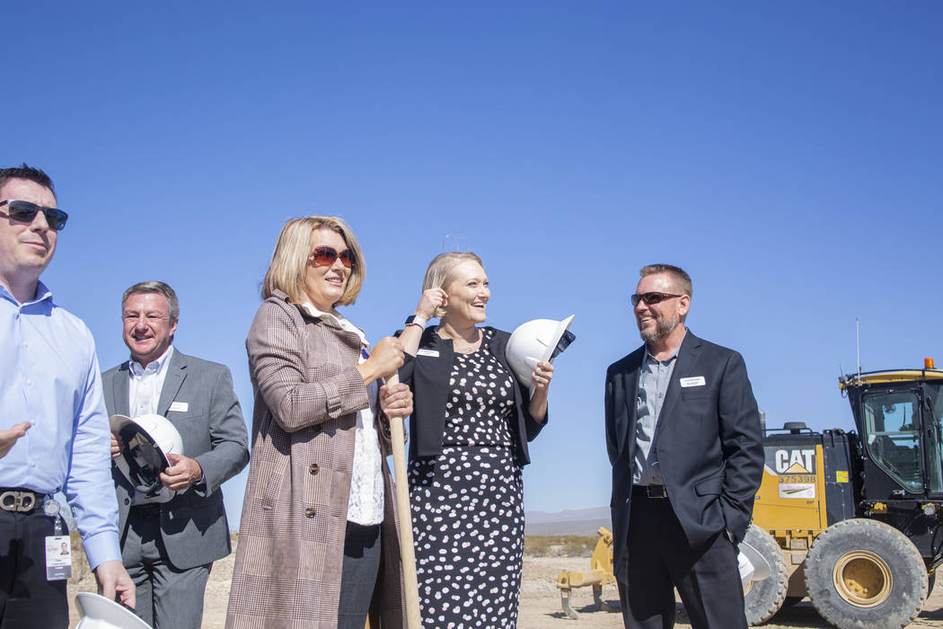 Individuals representing Lennar, Shea Homes and Woodside Homes celebrate the ground breaking of ...