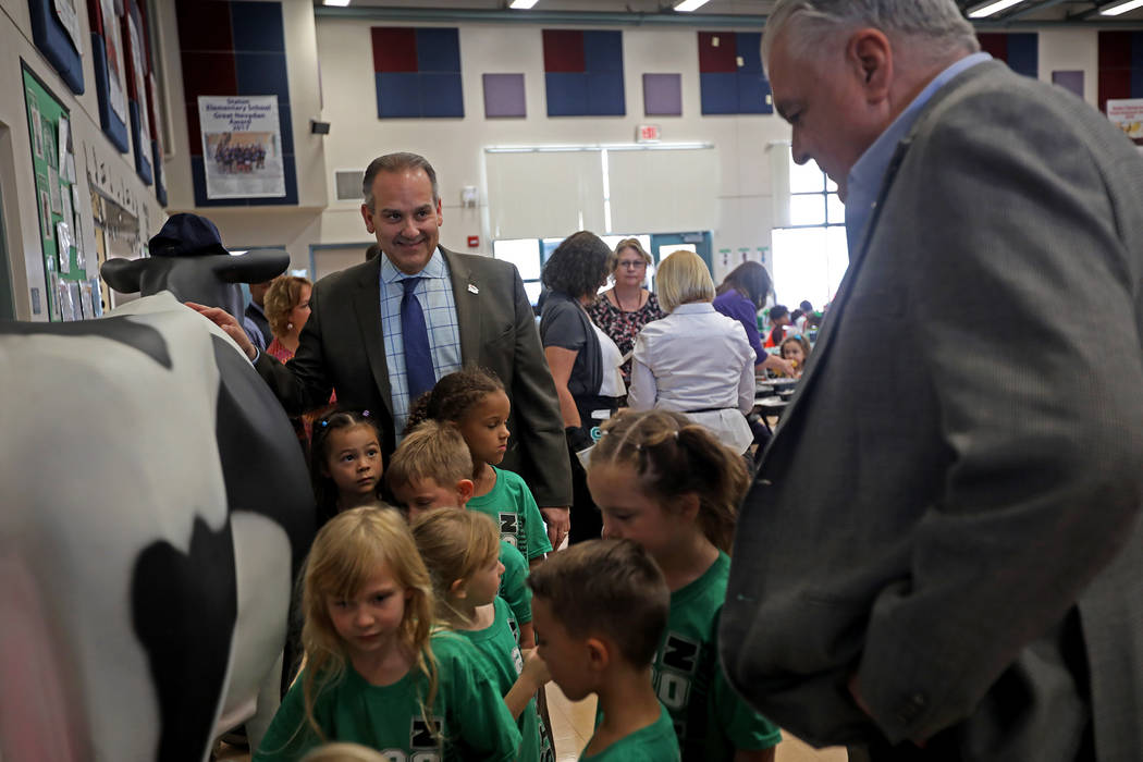 Clark County School District Superintendent Jesus Jara, center, laughs with Gov. Steve Sisolak, ...