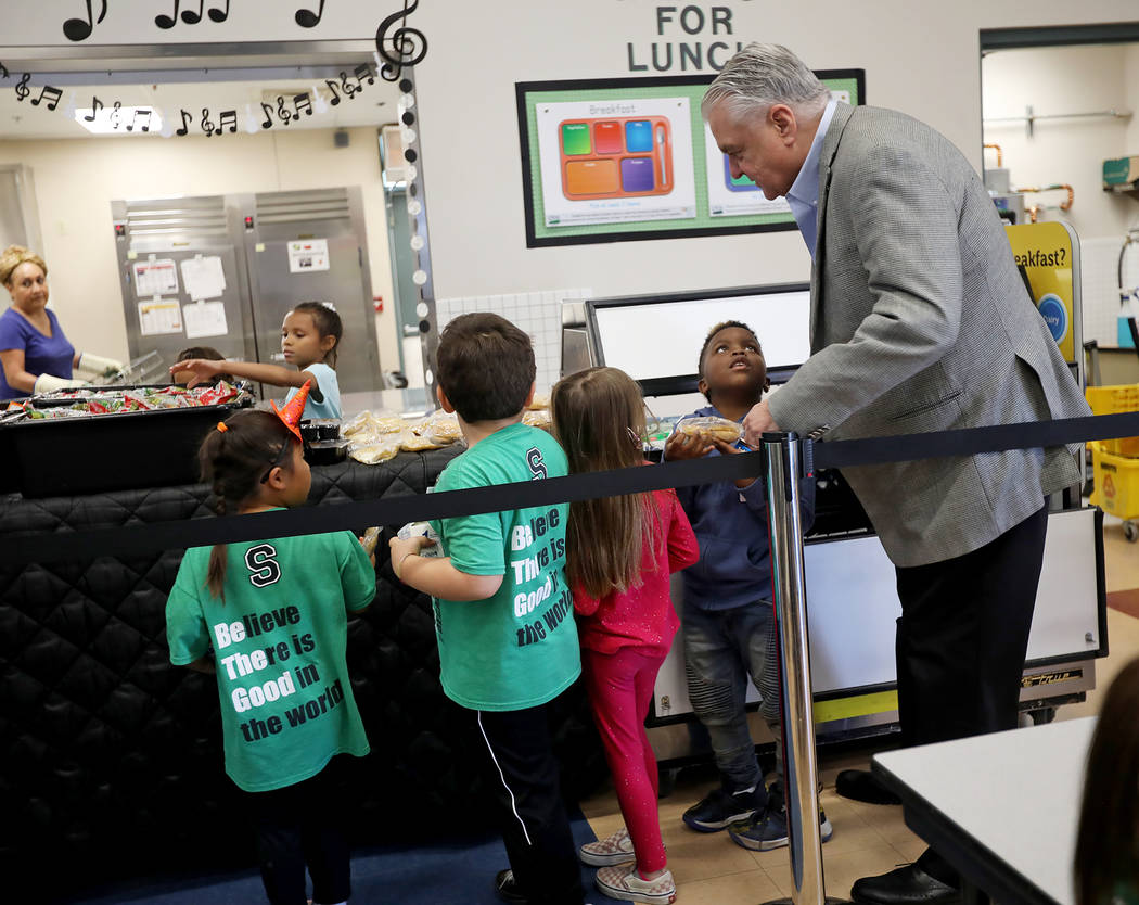 Gov. Steve Sisolak talks to student Samar Sims, 5, in the lunch line at Staton Elementary Schoo ...