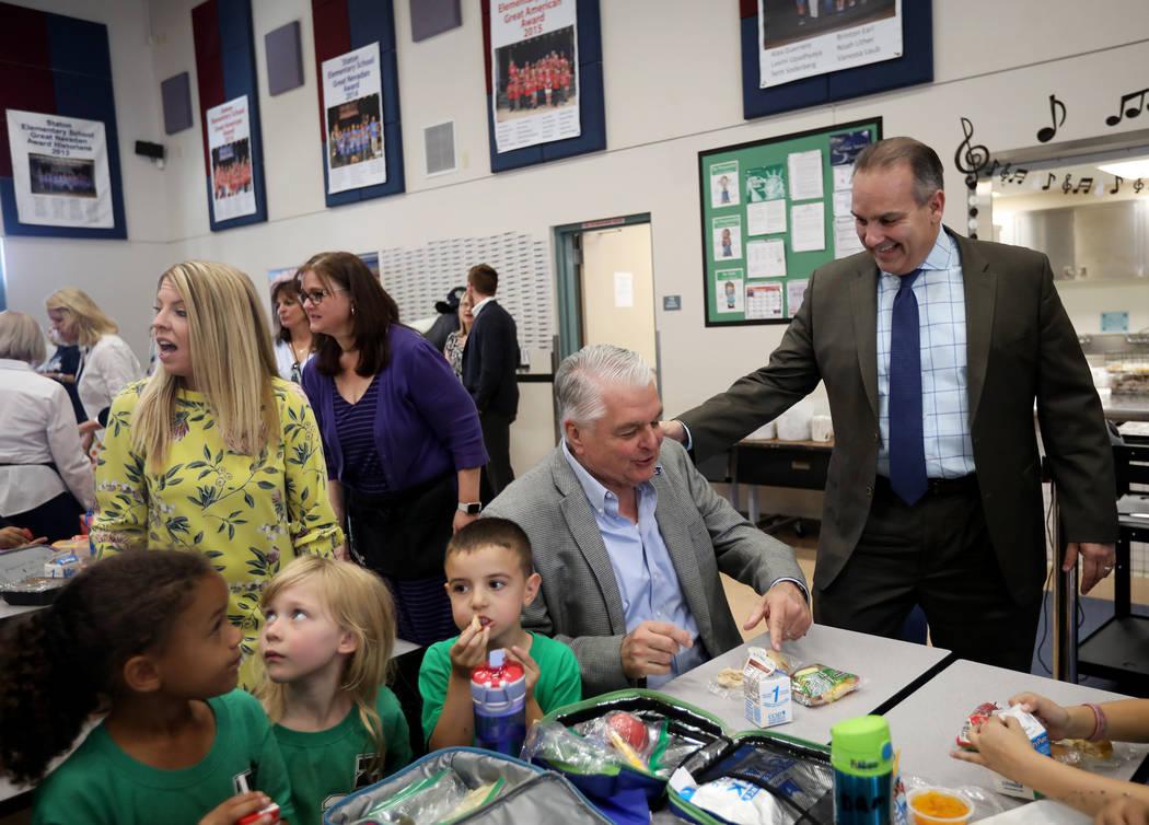 Clark County School District Superintendent Jesus Jara, right, greets Gov. Steve Sisolak as he ...