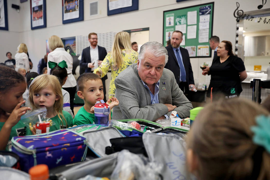 Gov. Steve Sisolak has lunch with Cade Christafaris, 5, from left, and Elizabeth Belger, 5, at ...