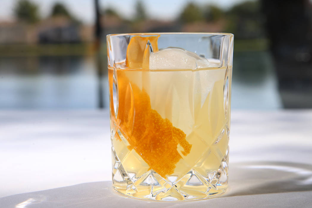 The Clarified Milk Punch cocktail served with gin honey, early grey tea, milk, and brandy, at A ...